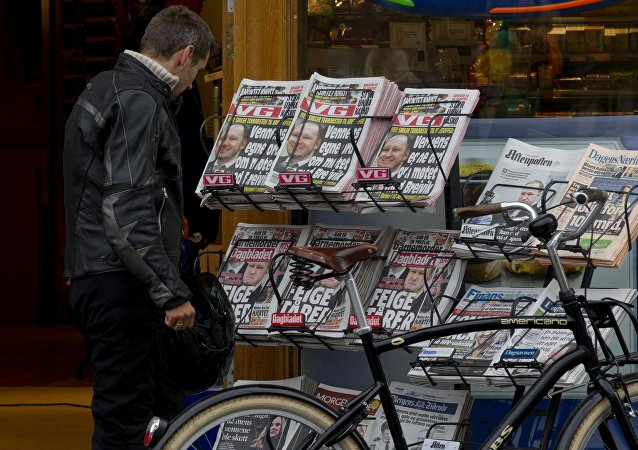 A man watch Norwegian newspapers VG and Dagbladet's front pages in Oslo