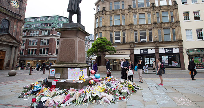 People stop to look at flowers and messsages on an impromptu memorial in St Anns Square for the victims of an attack at Manchester Arena, Manchester, Britain, May 24, 2017.
