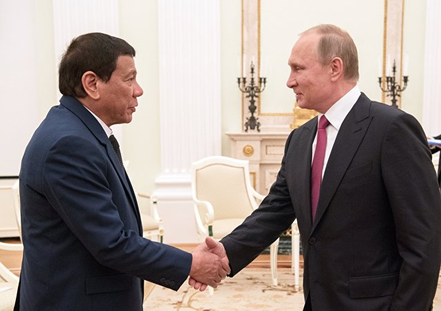 President Vladimir Putin at a meeting with President of the Philippines Rodrigo Duterte, left