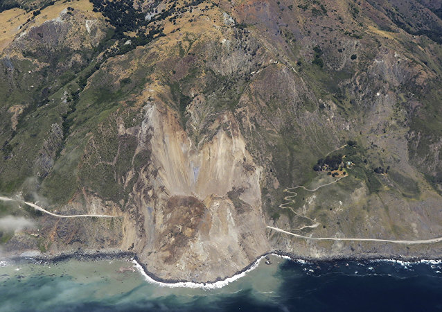 In this aerial photo taken Monday, May 22, 2017 provided by John Madonna showing a massive landslide along California's coastal Highway 1 that has buried the road under a 40-foot layer of rock and dirt.