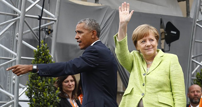 German Chancellor Angela Merkel and former U.S. President Barack Obama wave at the end of a discussion at the German Protestant Kirchentag in front of the Brandenburg Gate in Berlin, Germany, May 25, 2017