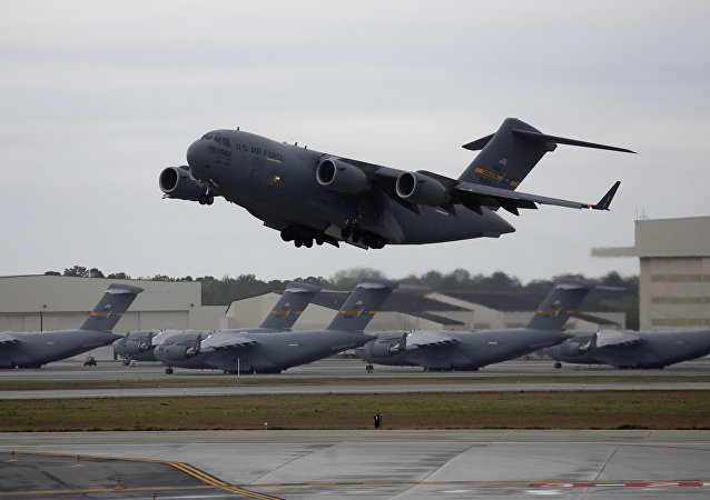 An Air Force C-17 Globemaster, made by Boeing, prepares to land at Charleston International Airport at Joint Base Charleston in North Charleston, S.C., Friday, March 31, 2017