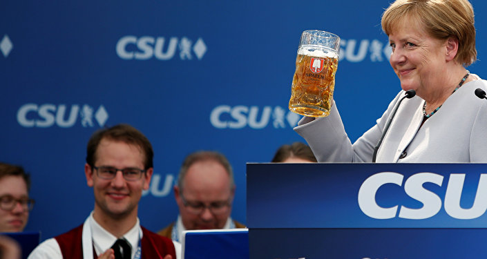 German Chancellor and head of the Christian Democratic Union (CDU) Angela Merkel toasts during the Trudering festival in Munich, Germany, May 28, 2017