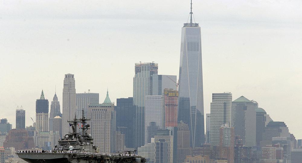 The USS Kearsarge moves past lower Manhattan as part of New York's Fleet Week as seen from Weehawken, N.J., Wednesday, May 24, 2017. New York's Fleet Week kicked off with a parade of ships up the Hudson River.