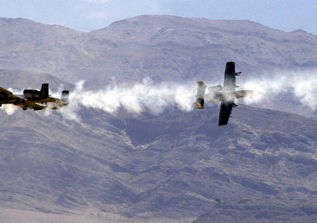 Two A-10 Warthogs firing their GAW 30mm Gatling guns