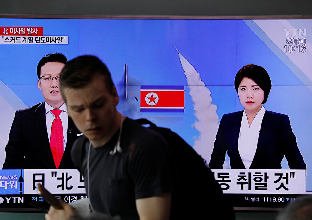 People watch a television broadcasting a news report on North Korea firing what appeared to be a short-range ballistic missile, at a railway station in Seoul, South Korea, May 29, 2017