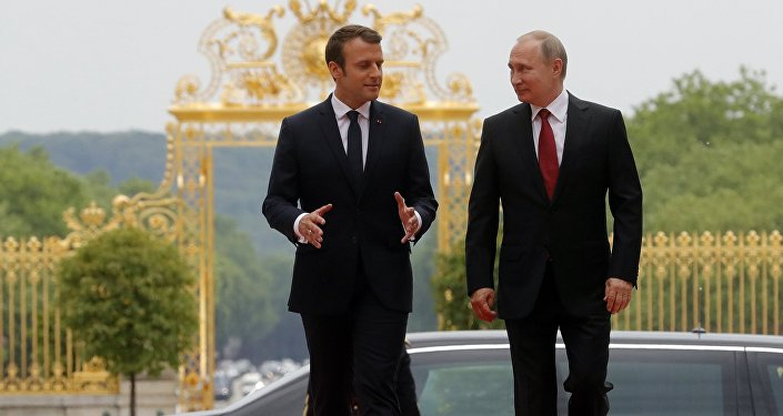 Russian President Vladimir Putin and French President Emmanuel Macron (left) meeting at the Grand Trianon of the Versailles Palace in Paris, May 29, 2017