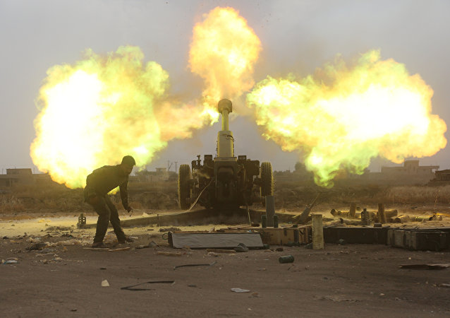 Popular Mobilization Forces (PMF) fire towards Islamic State militants during a battle on the outskirts of Al-Ba'aj, west of Mosul, Iraq May 26, 2017