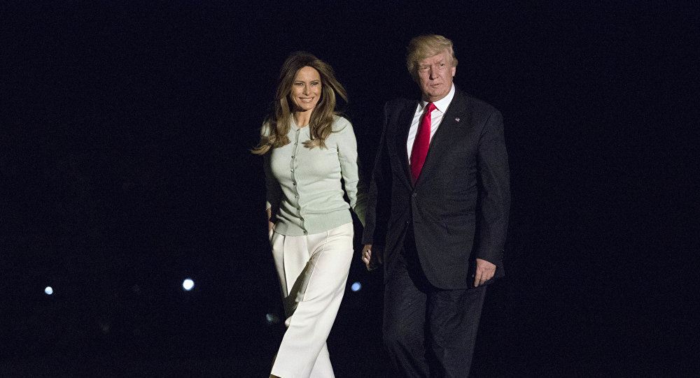President Donald Trump and first lady Melania Trump walk from Marine One across the South Lawn to White House in Washington, Saturday, May 27, 2017, as they return from Sigonella, Italy