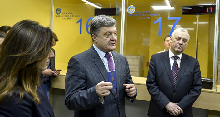 Ukrainian President Petro Poroshenko with a new biometric passport