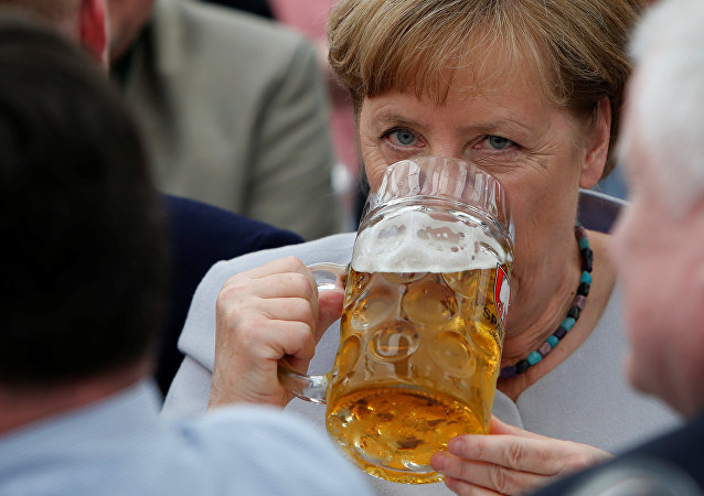 German Chancellor and head of the Christian Democratic Union (CDU) Angela Merkel drinks during the Trudering festival in Munich, Germany, May 28, 2017