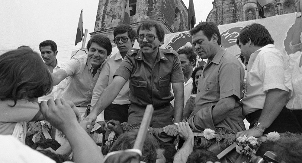 FILE - In this Oct. 28, 1984 file photo, Nicaraguan presidential candidate for the Sandinista National Liberation Front Daniel Ortega reaches out to supporters during a final campaign appearance in Leon, Nicaragua