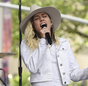 FILE - In this May 26, 2017 file photo, singer Miley Cyrus performs on NBC's Today show in New York. Cyrus will join Ariana Grande at a charity concert called One Love Manchester in Manchester, England, Sunday, June 3, 2017, two weeks after a bomber killed 22 people at Grande's concert in Manchester