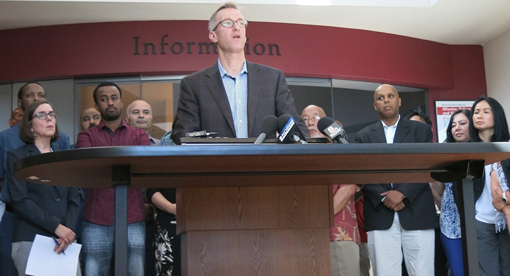 Portland Mayor Ted Wheeler speak at a news conference after a man fatally stabbed two men Friday on a light-rail train when they tried to stop him from yelling anti-Muslim slurs at two young women, one of whom was wearing a hijab, in Portland, Ore., Saturday, May 27, 2017.