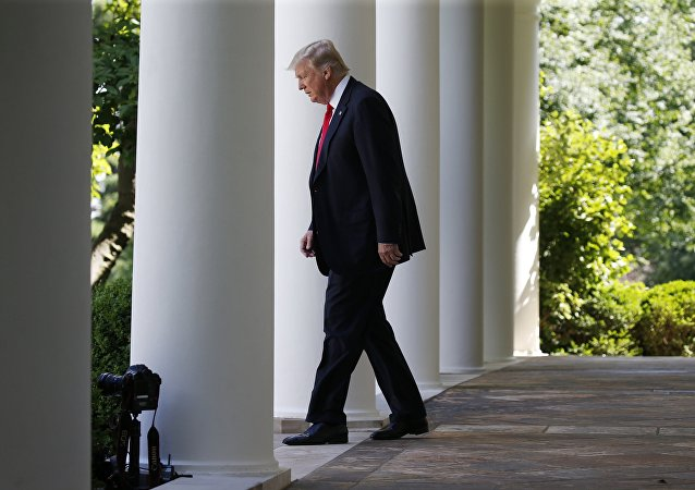 U.S. President Donald Trump enters the Rose Garden from the White House colonnade to announce his decision to leave the Paris Climate Agreement in the Rose Garden of the White House in Washington, U.S., JJune 1, 2017