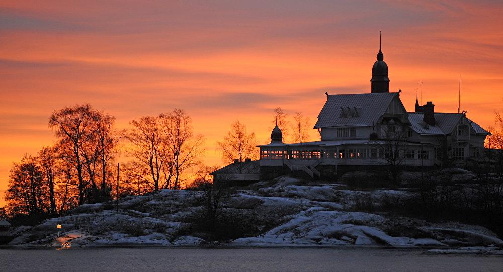 The sun sets over an island in the Helsinki archipelago