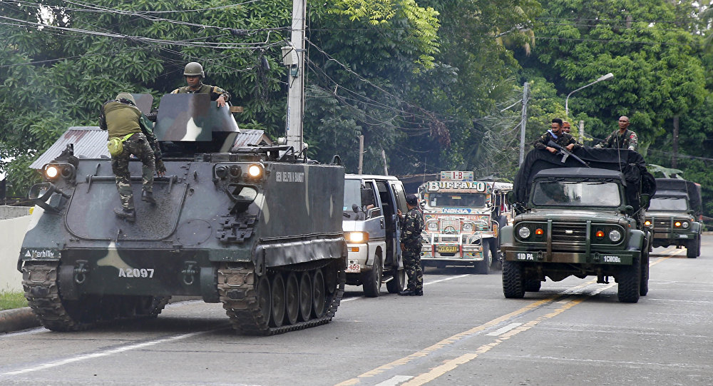 Tanks arrive at a military camp in Iligan city to reinforce Government troops who are battling Muslim militants who laid siege in Marawi city for over a week now Wednesday, May 31, 2017 in southern Philippines. Fighting continues for the second week now between Government troops and Muslim militants with casualties on both side and civilians.