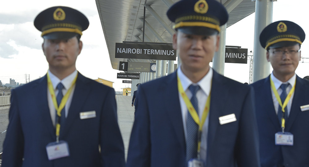 Kenya Railways attendants from China upon arrival from Mombasa in a train launched to operate on the Standard Gauge Railway (SGR) on May 31, 2017 in Nairobi.