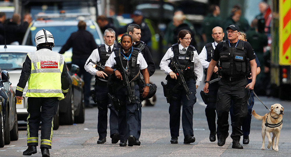 Armed police officers walk outside Borough Market after an attack left 6 people dead and dozens injured in London, Britain, June 4, 2017