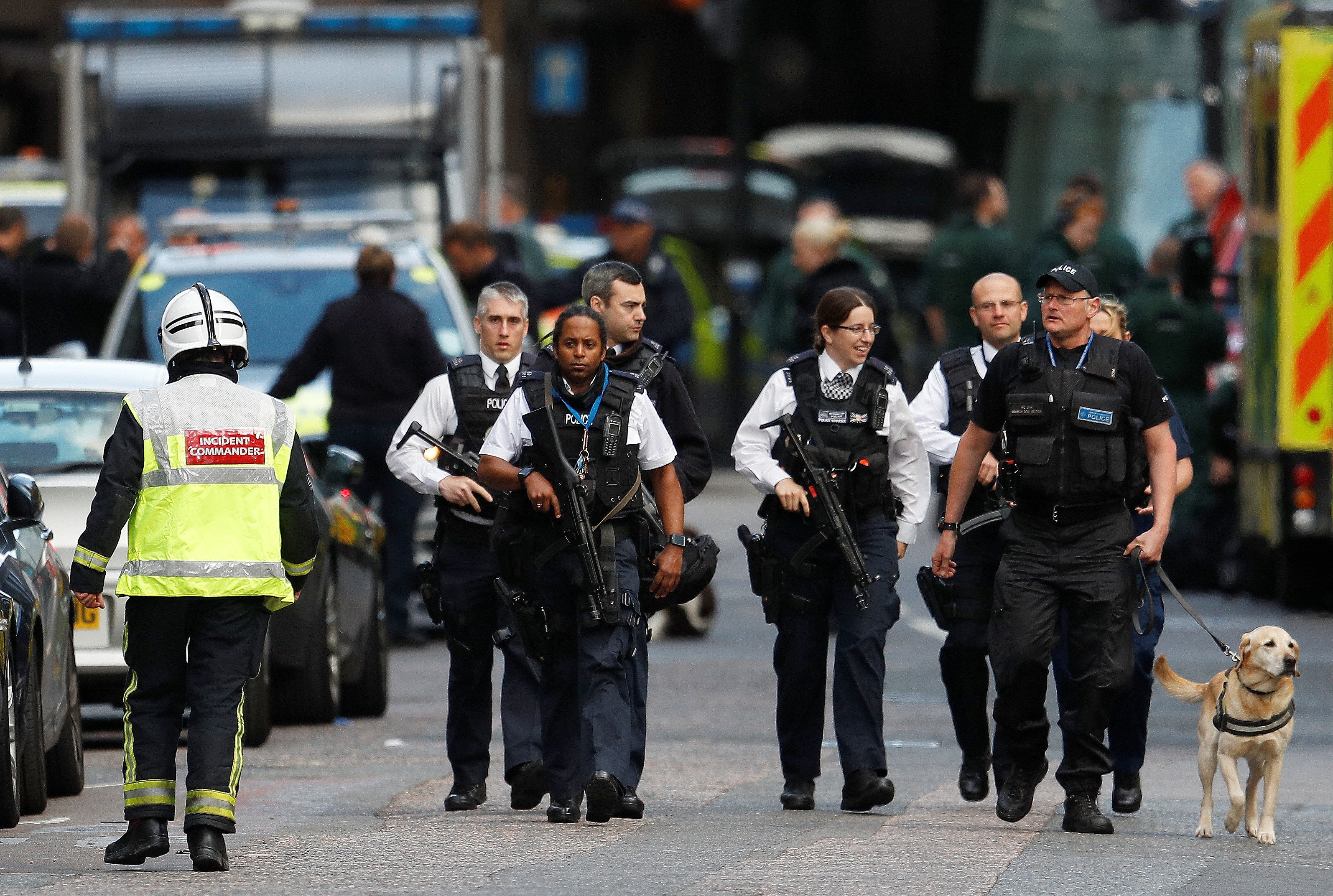 Armed police officers walk outside Borough Market after a terror attack in London, Britain.