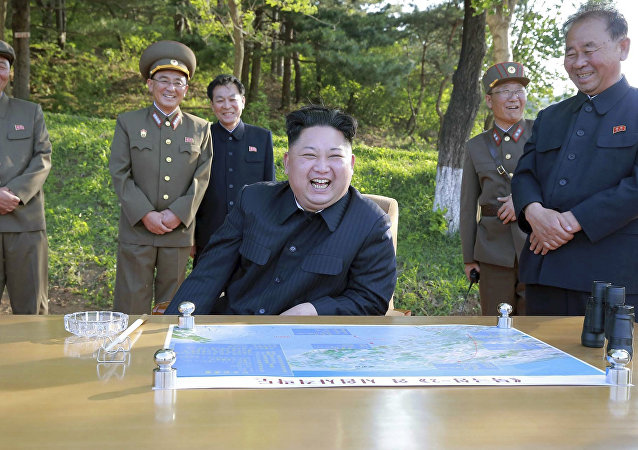 North Korean leader Kim Jong Un watches the test launch of a solid-fuel Pukguksong-2 at an undisclosed location in North Korea