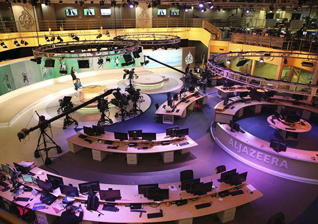 Staff members of Al-Jazeera International work at the news studio in Doha, Qatar (File)
