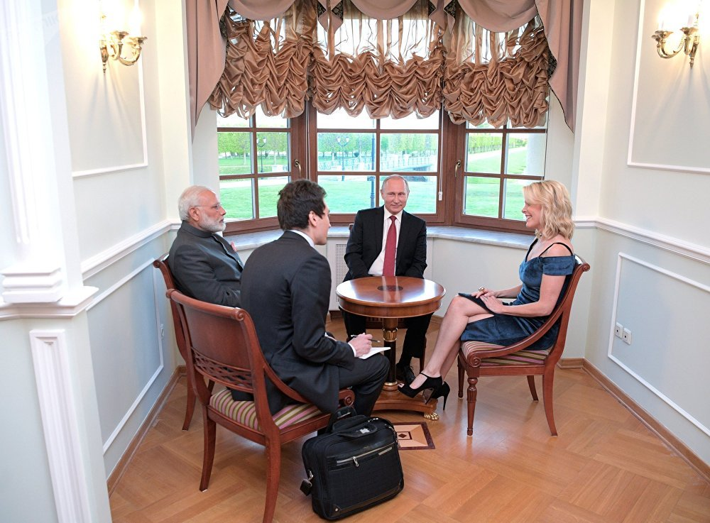 June 1, 2017. Russian President Vladimir Putin and Indian Prime Minister Narendra Modi, left, talk to US journalist and NBC anchor Megyn Kelly, right, in the Constantine Palace in Strelna