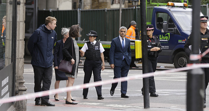 London Police Commissioner Cressida Dick, center left, and the Mayor of London Sadiq Khan, center right, walk near the London Bridge and Borough Market area in London, Monday, June 5, 2017