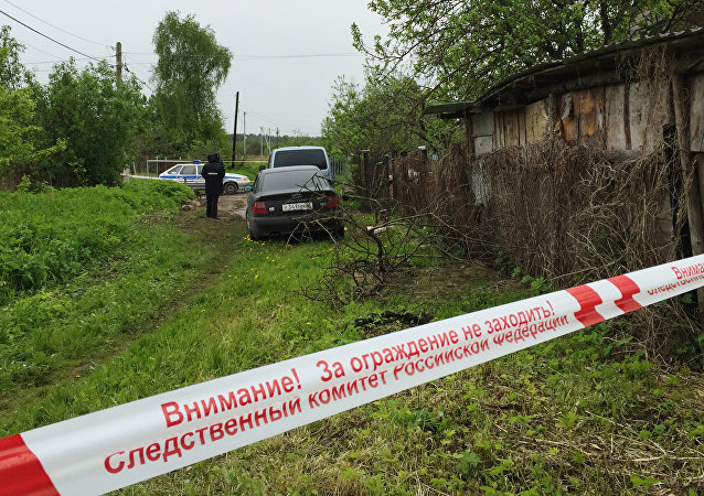 A police tape outside a house in Redkino gardening community in the Tver Region where a man shot down nine persons during a domestic conflict on the night of June 4