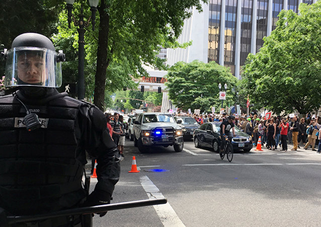 Thousands of protesters gather in Portland, Oregon, Sunday, June 4, 2017, for competing rallies following last month's fatal stabbing of two men on a light-rail train by a man police say was shouting anti-Muslim slurs.