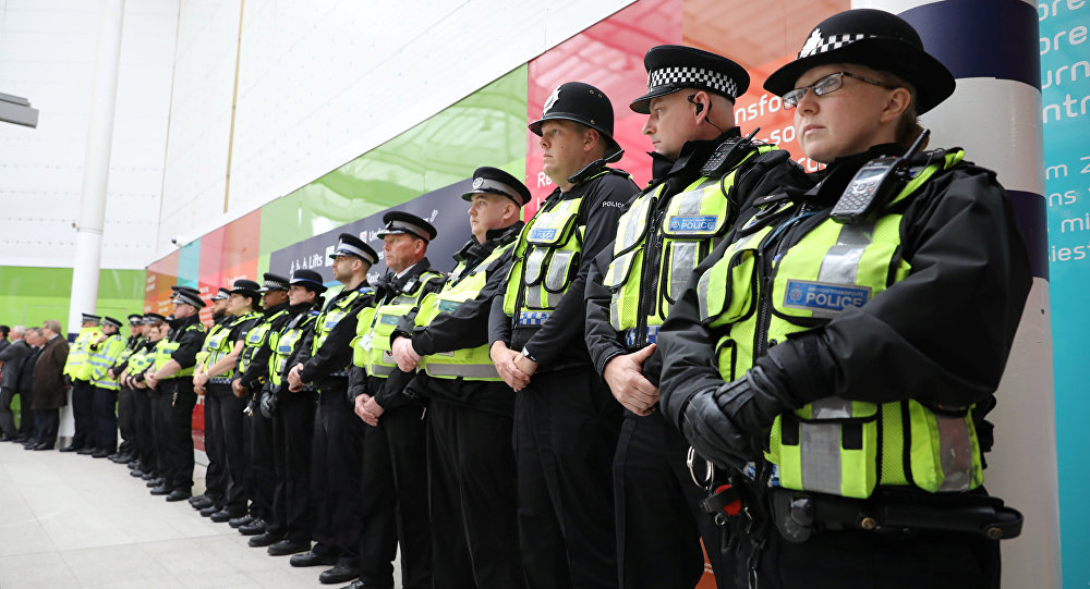 Police officers observe a minute's silence for the victims of the attack on London Bridge and Borough Market at London Bridge Station, London, Britain, June 6, 2017
