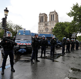 French police stand at the scene of a shooting incident near the Notre Dame Cathedral in Paris, France, June 6, 2017