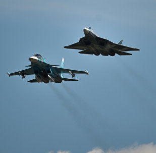 From left: A Sukhoi-34, a T-50 and a Sukhoi-35S perform a demo flight at the MAKS 2015 International Aviation and Space Salon in Zhukovsky outside Moscow