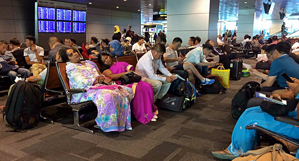Passengers of cancelled flights wait in Hamad International Airport (HIA) in Doha, Qatar, Tuesday, June 6, 2017