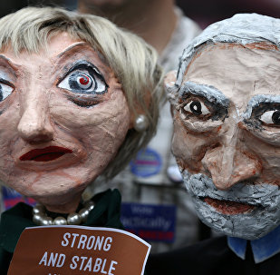 Puppets of Conservative Party leader Theresa May and Labour Party leader Jeremy Corbyn are seen during a protest against the BBC's broadcast restrictions on the Captain Ska song Liar Liar outside Broadcasting House in London, Britain June 2, 2017.