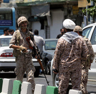 Members of the Iranian Revolutionary Guard secure the area outside the Iranian parliament during an attack on the complex in the capital Tehran on June 7, 2017
