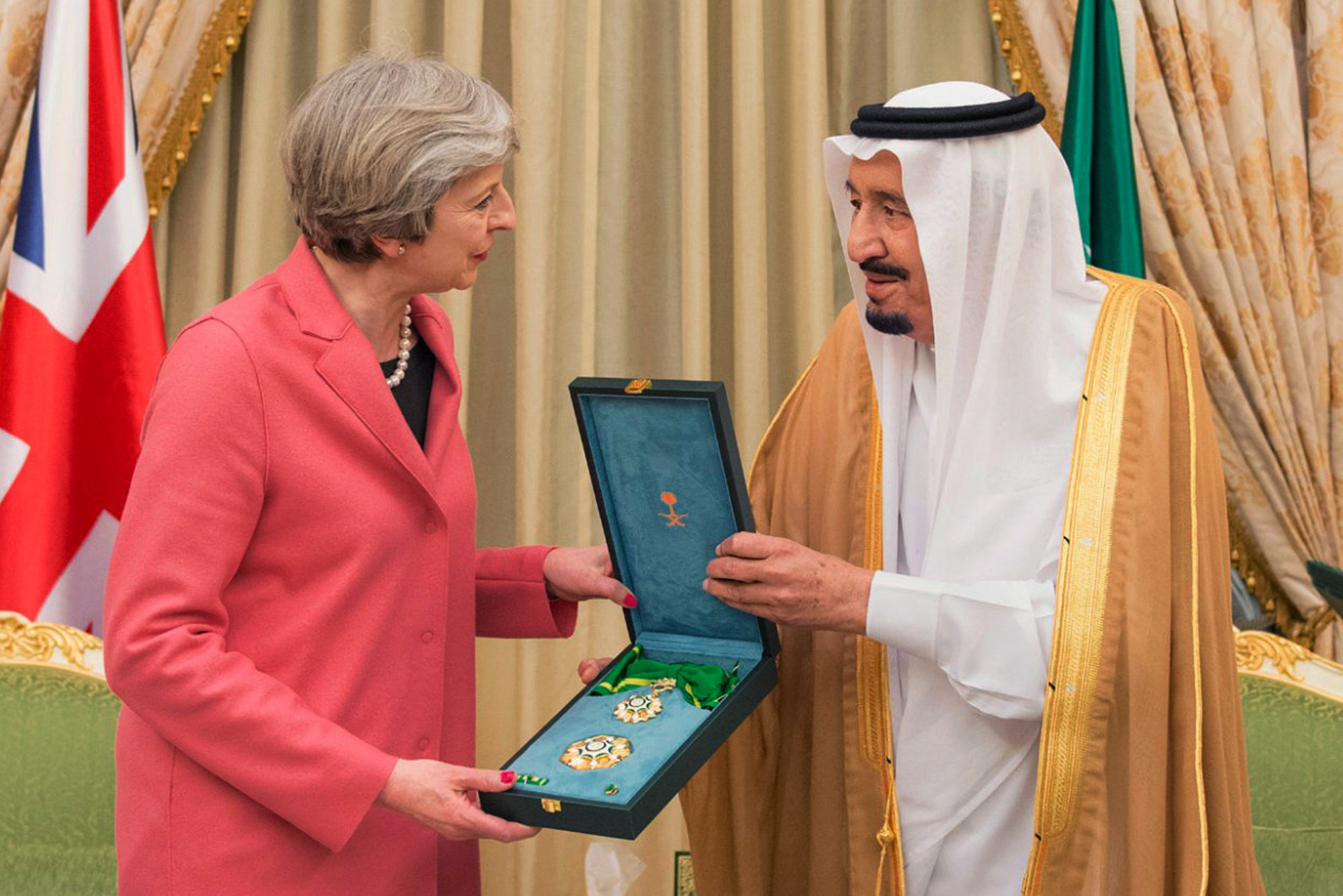 In this photo released by Saudi Press Agency, SPA, Saudi King Salman, right, presents a gift to British Prime Minister Theresa May, in Riyadh, Saudi Arabia, Wednesday, April 5, 2017