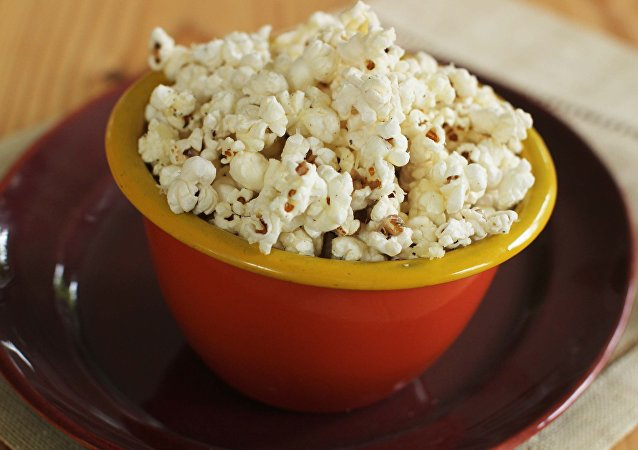 With parmesan garlic popcorn, you can go either sweet or savory when making popcorn treats