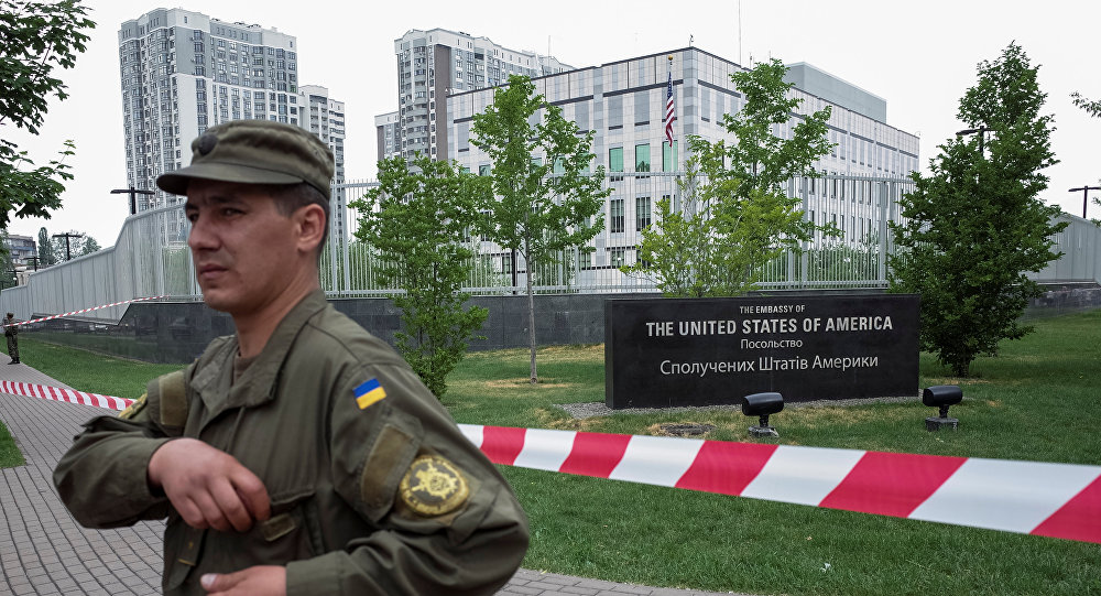 A member of the National Guard stands guard in front of the U.S. embassy in Kiev, Ukraine, June 8, 2017.