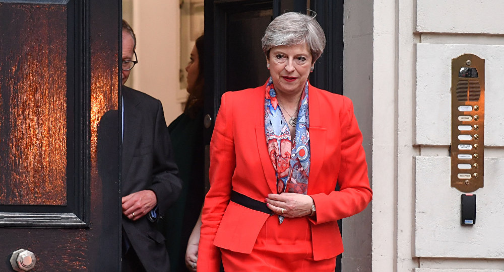 British Prime Minister Theresa May leaves the Conservative Party HQ in central London, on June 9, 2017, hours after the polls closed in the British general election.