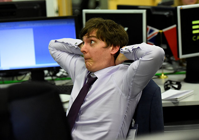 An ETX Capital trader reacts as he watches the results for Britain's election in London, June 8, 2017.