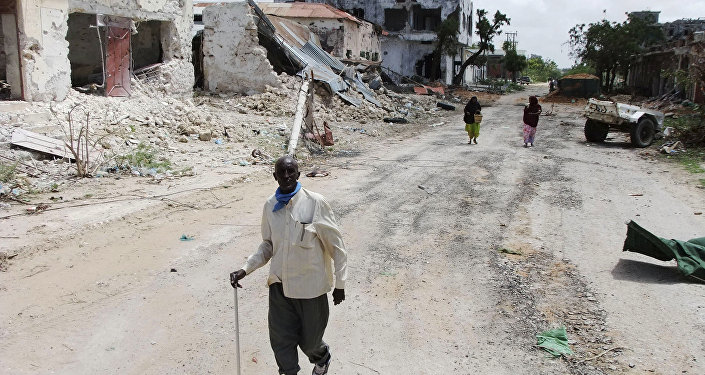 Civilians walk along a street in Mogadishu, Somalia. (File)