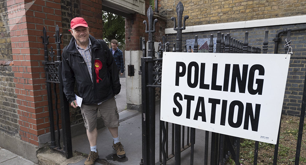A supporter of the Labour Party leaves a polling station in London after voting the United Kingdom general election of 2017