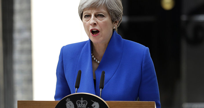 British Prime Minister Theresa May addresses the press in Downing street, London, Friday, June 9, 2017 following an audience with Britain's Queen Elizabeth II at Buckingham Palace where she asked to form a government.