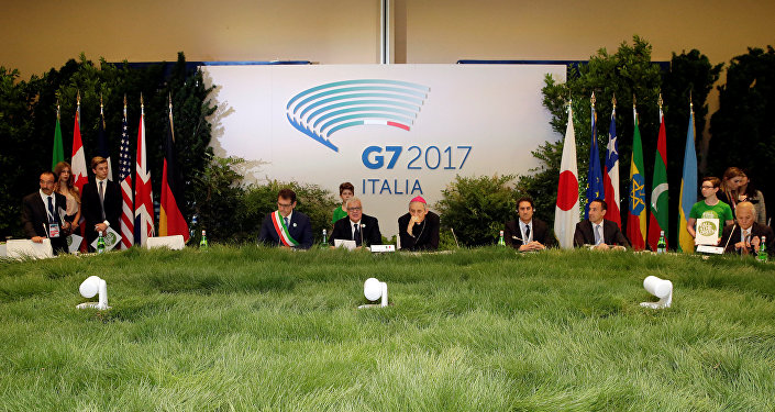 Italy's Minister of the Environment Gian Luca Galletti (C) attends a summit of Environment ministers from the G7 group of industrialised nations in Bologna, Italy, June11, 2017