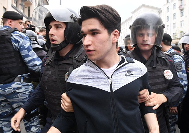 A young man detained during an unauthorized rally on Tverskaya Street, Moscow