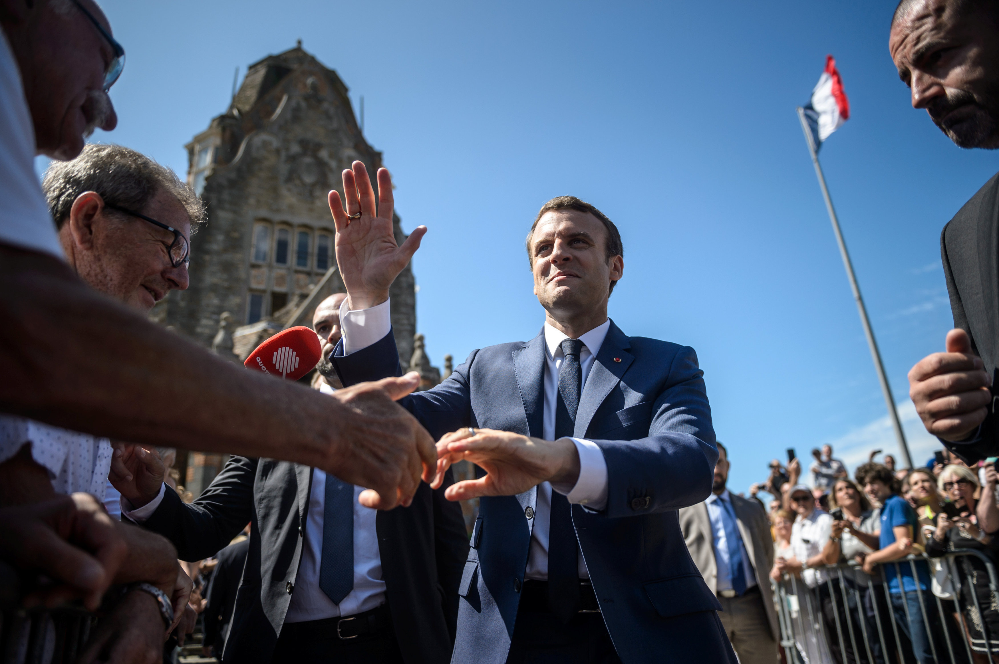French President Emmanuel Macron leaves the polling station after voting in the first of two rounds of parliamentary elections in Le Touquet, France, June 11, 2017