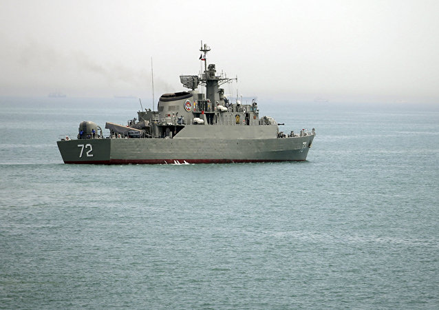 In this Tuesday, April 7, 2015, file photo released by the semi-official Fars News Agency, Iranian warship Alborz, foreground, prepares before leaving Iran's waters, at the Strait of Hormuz