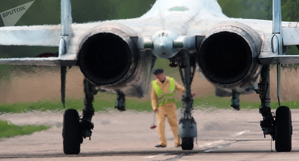 Aeromechanic conducts preflight inspection of the Su-27 before the start of the training flight at the Chkalovsk airport in the Kaliningrad region. File photo