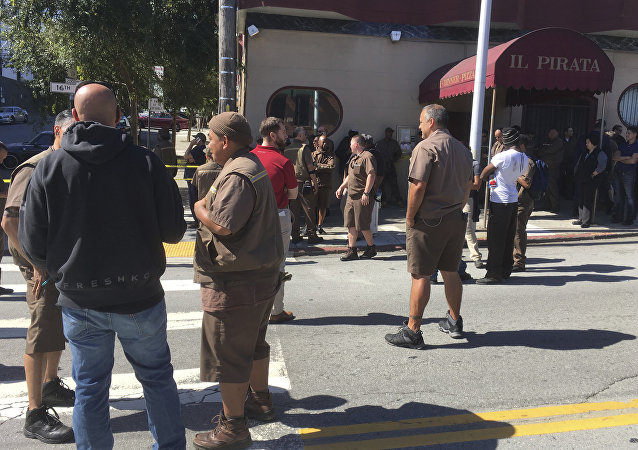 UPS workers gather outside after a reported shooting at a UPS warehouse and customer service center in San Francisco on Wednesday, June 14, 2017